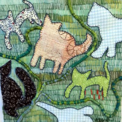 kattsiluetter mot grön bakgrund fritt broderi av Ann Rydh